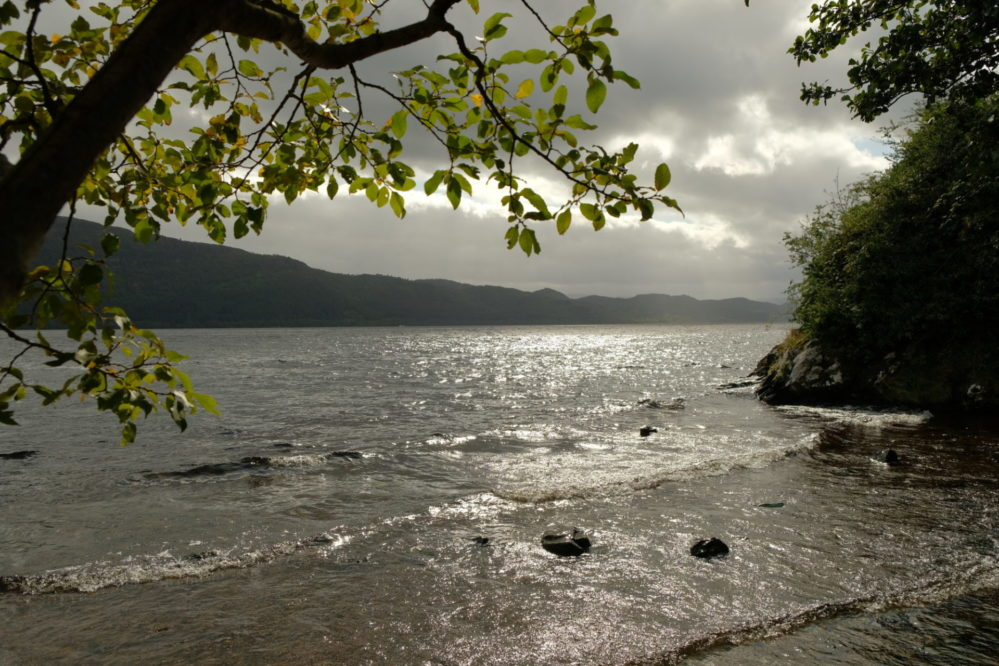 View of the shores of Loch Ness from the beach at Urquhart Castle
