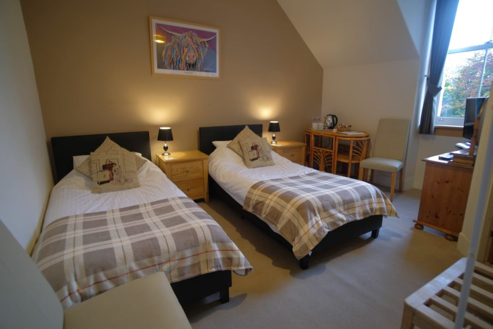 A gorgeous view of the Glen Etive twin bedroom with en-suite