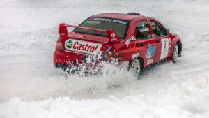 Rally car in snow - Photo by Ferhat Deniz Fors on Unsplash