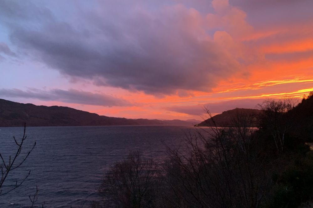 Beautiful sunset over Loch Ness and Urquhart Castle
